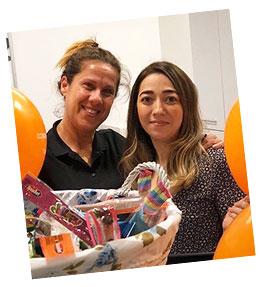 Women receive gift basket during Customer Service Week.